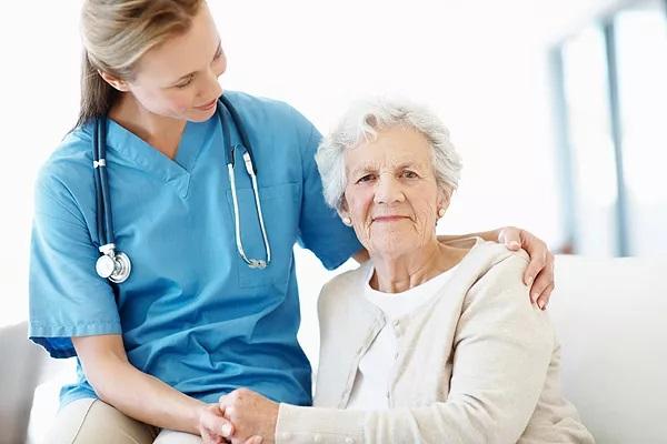 nurse sitting with patient